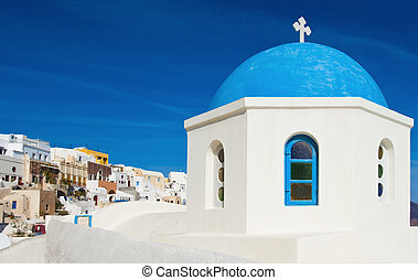Greek chapel in Santorini - One of the famous blue dome...