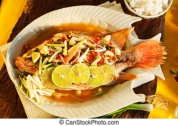 Thai food - Red snapper with garlic, chili, lemon grass and...