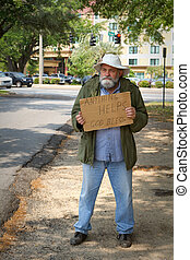 Homeless Beggar - Disheveled homeless man stands by the side...