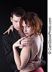 Man and red naked woman - lovers portrait