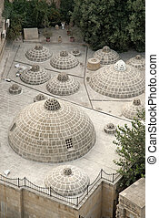 traditional rooftop domes in baku azerbaijan - traditional...