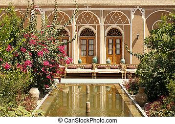 interior garden with pond in yazd iran - house interior...