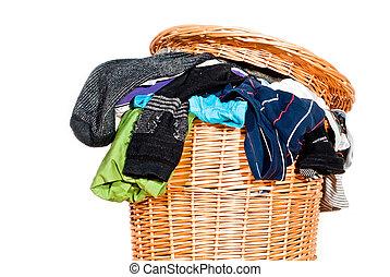 full laundry basket V1 - a laundry basket fully with laundry...