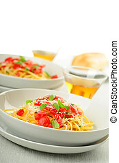 Linguini topped with fresh ripe tomatoes and herbs.