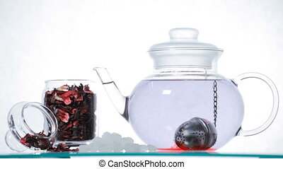 TL Woman preparing red Hibiscus tea - Time-lapse Woman puts...