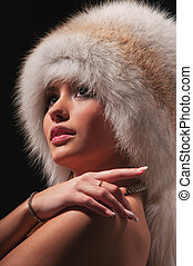 beautiful young woman in a fur hat