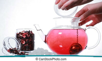 Woman preparing red Hibiscus tea