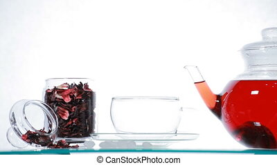 Woman take red Hibiscus tea - Woman pours red Hibiscus tea...