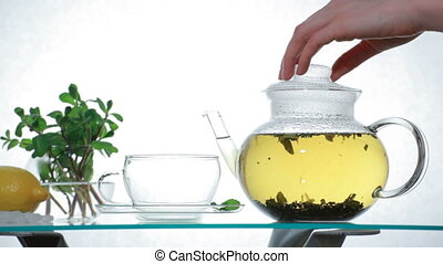 Herbal Tea in clear glass teapot, 5DII, 1080p, 2997 fps, 130...