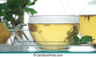 Woman adds sugar in glass of tea