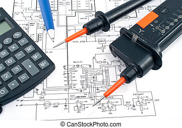 Voltage tester,calculator and pen on electrical diagram