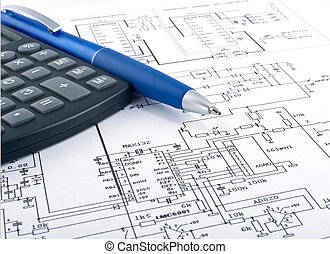 Calculator and pen on electrical diagram - Calculator and...