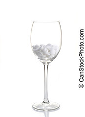 white tablets lie in  glass for wine