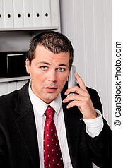 Businessman in office with telephone - Young Business man in...