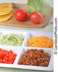 Taco Ingredients - Beef, tomato, lettuce, cheese and shells...