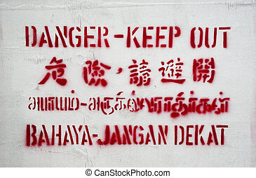 English, Malay, Chinese and Tamil sign - singapore danger...