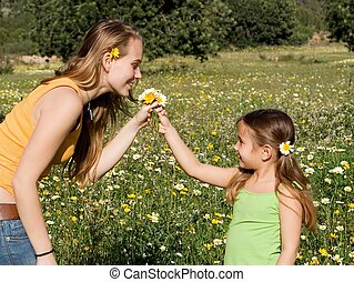 kid giving flower to mum
