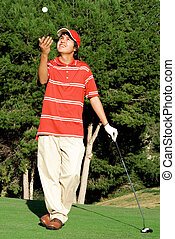 golf junior with ball and club
