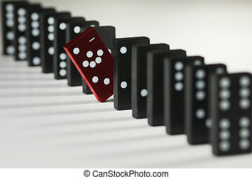 not like the others - red domino token among black domino...