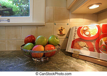 Kitchen with apples and cooking book