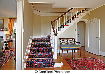 Beautiful staircase with luxury rug
