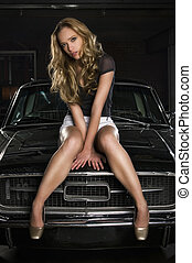 on a car - pretty young woman sitting on an old car