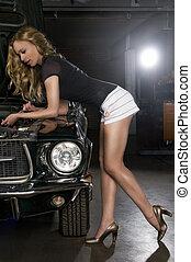 car repair? - pretty young woman in a car shop