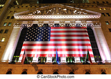 NYSE - The New York Stock exchange illuminated at night. May...