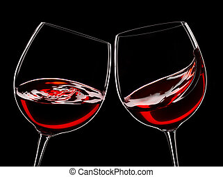 two glasses of red wine, isolated over black