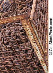 Cage with scrap iron - Rusty scrap iron in iron cage