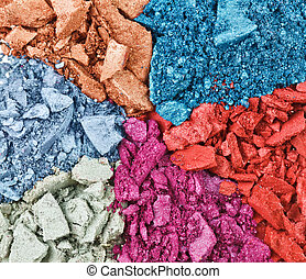 Set of broken multicolor eye shadow, background macro