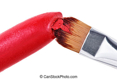 Makeup brush pushed in on red lipstick, isolated on white