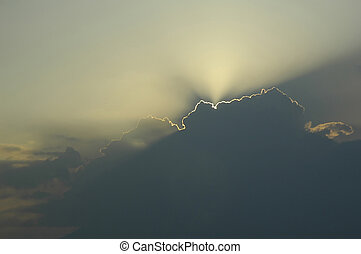 sun through  clouds - sun rays shining through  clouds