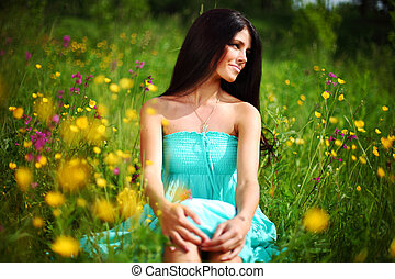 natural freedom - beautiful woman on flower field