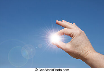 Sun In your hands - Mans hands holding sun rays
