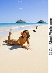 Polynesian girl in an orange bikini - beautiful young...