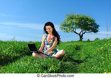 laptop work in field - laptop work in green grass field