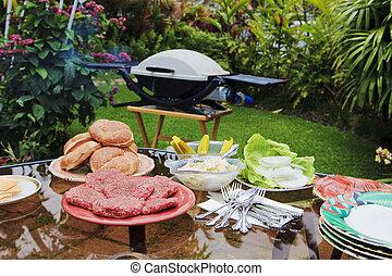 backyard bar-b-que in a tropical garden
