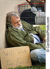 Hopeless Homeless - Homeless and hopeless man in an old army...