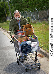 Homelessness - Homeless Vietnam veteran pushes a shopping...