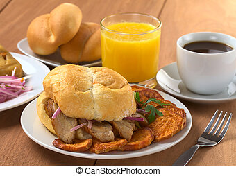 Typical Peruvian breakfast consisting of Pan con Chicharron...