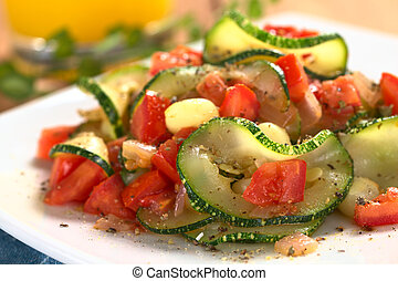 Sauteed zucchini slices, tomato cubes, onion and cooked corn...