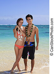 young couple at the beach in hawaii