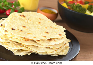 Indian flatbread called Chapati with vegetable curry, curry...