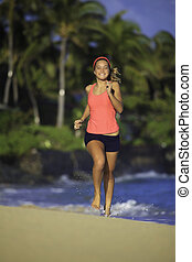 teenage girl running on the beach