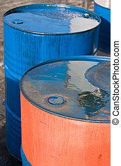 Blue and orange oil barrels 1 - Several blue and orange oil...