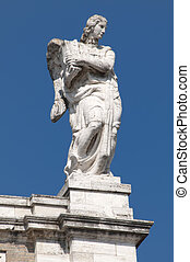 Particular of a statue on a church roof