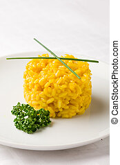 Risoto with saffron - photo of delicious yellow risotto with...
