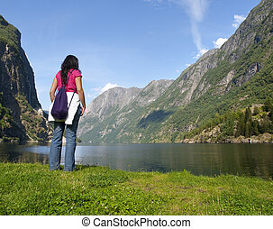 Woman relaxing in the fjord of Gudvangen - The Naeroyfjord...