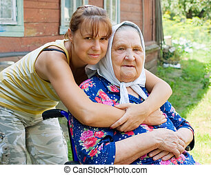 Grandmother and granddaughter embraced and happy -...